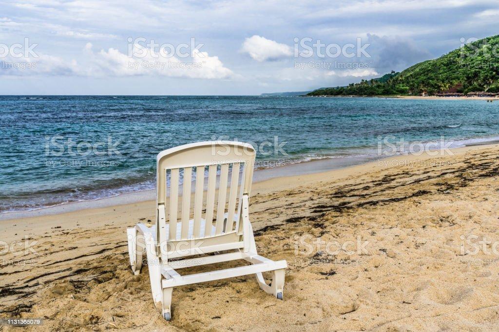 Plastic chair on the Caribbean beach on the island of Cuba.