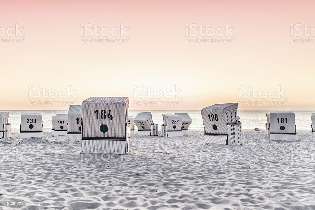 Beach - chair on the island Sylt on sunset. Germany. stock photo