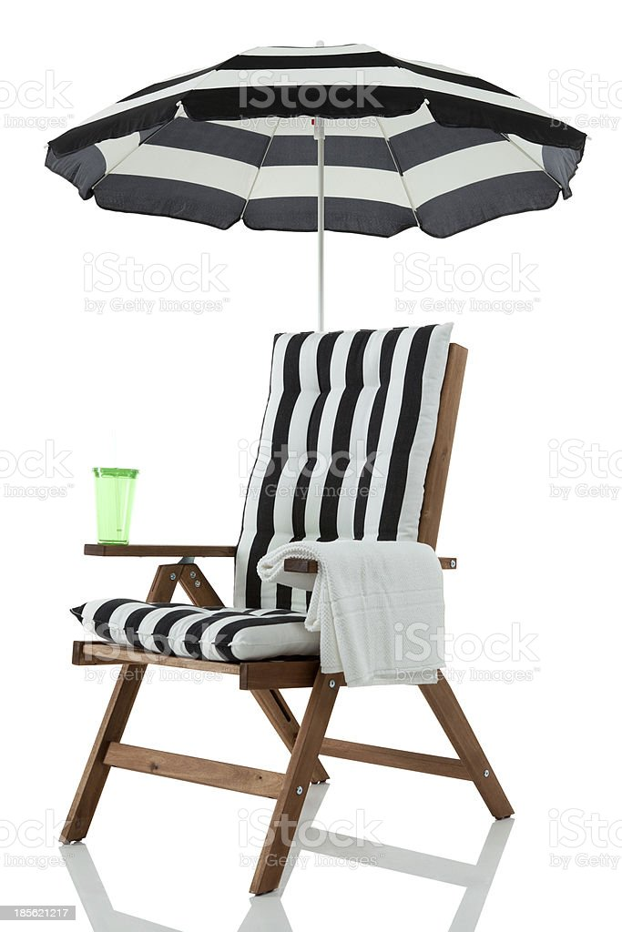 Beach Chair with Umbrella side royalty-free stock photo