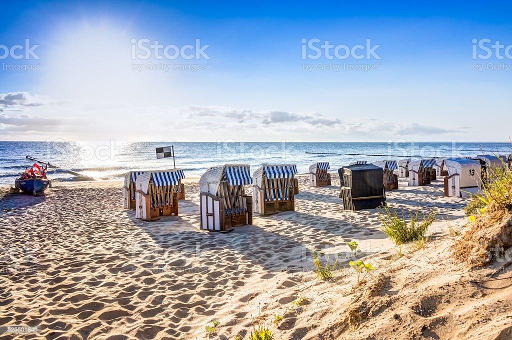 Beach chairs after sunrise stock photo