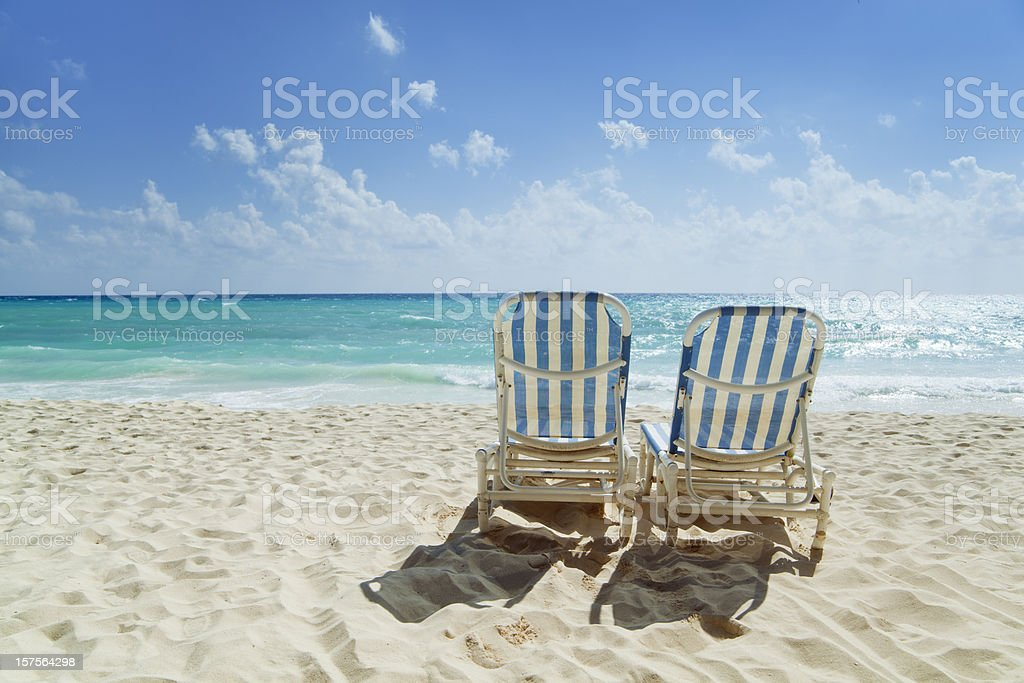 Beach Chairs Along the Caribbean Sea stock photo