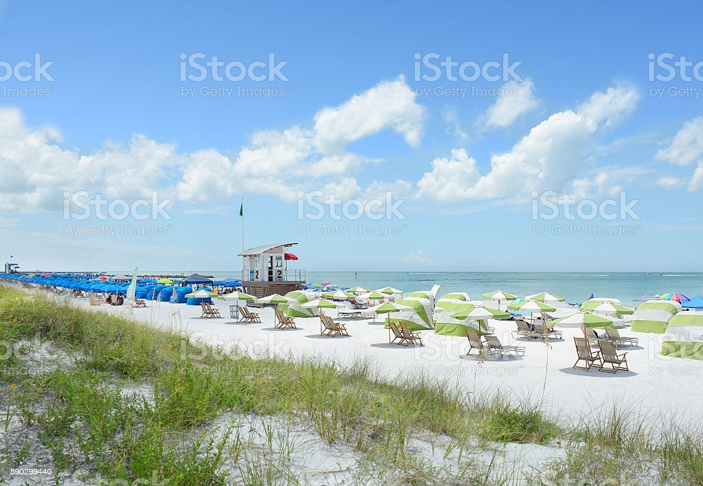 Beach chairs and parasols on beautiful white beach. royaltyfri bildbanksbilder