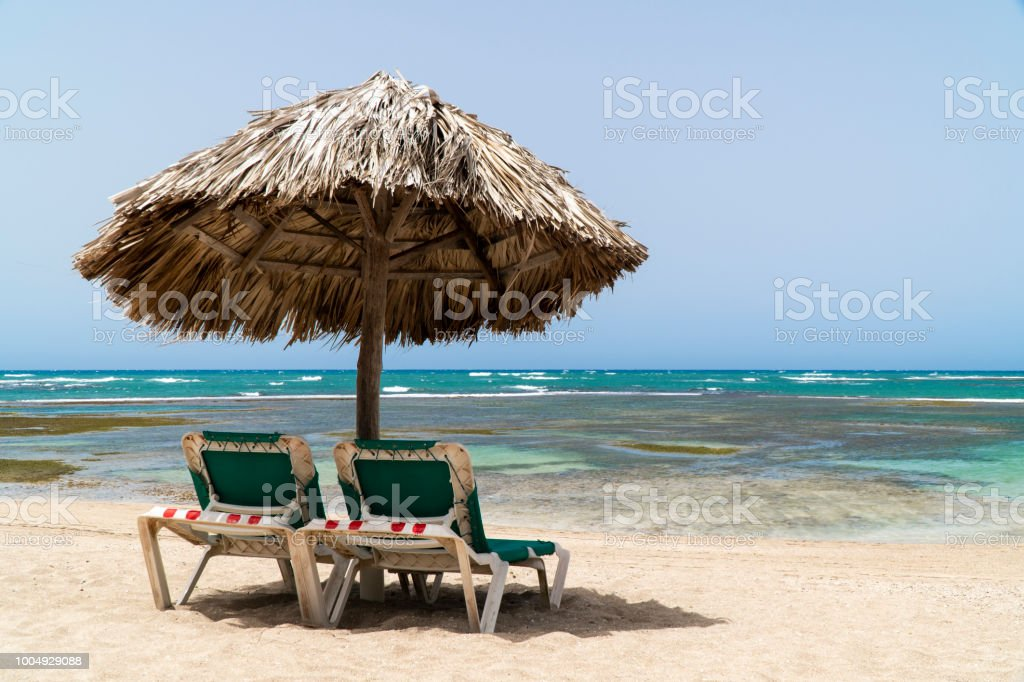 Beach Chairs and Umbrella at Puerto Plata beach in the Dominican Republic stock photo