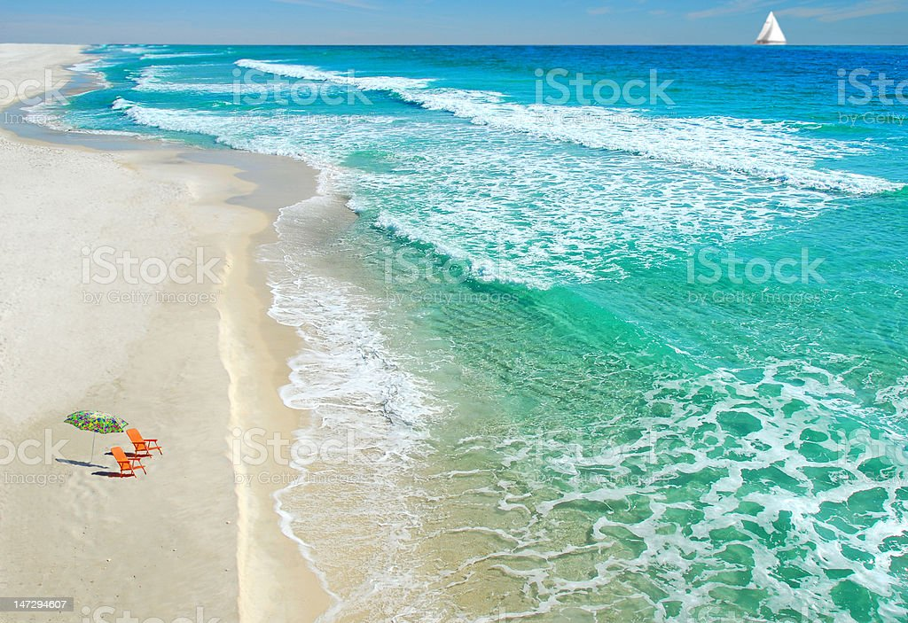 Beach chairs and umbrella stock photo