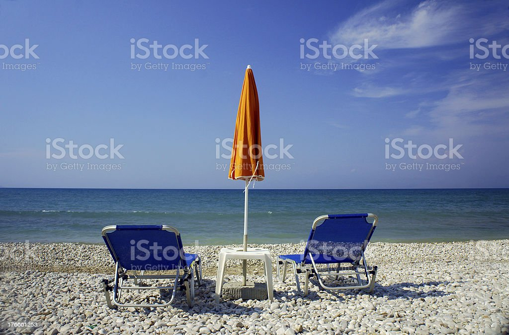 Beach chairs and umbrella royalty-free stock photo