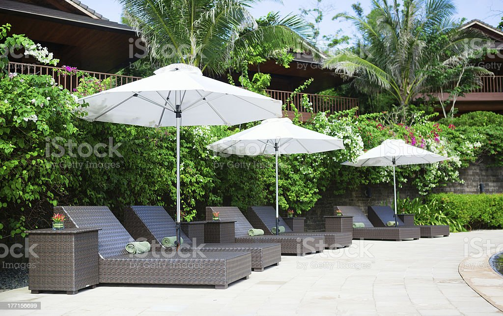 Beach chairs on a tropical resort royalty-free stock photo