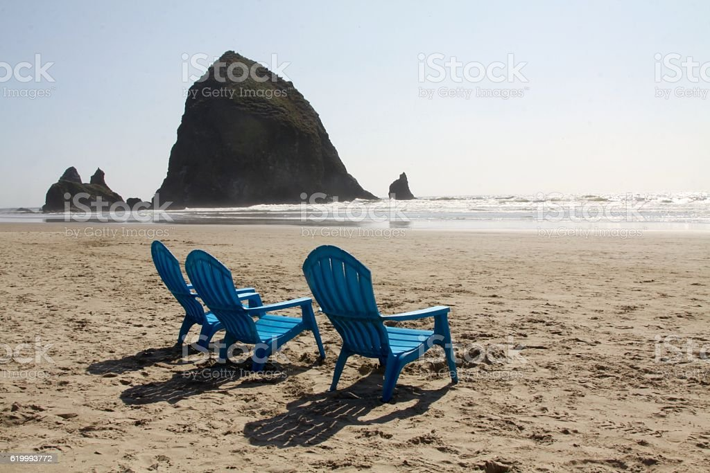 Beach Chairs On Cannon Beach Oregon stock photo