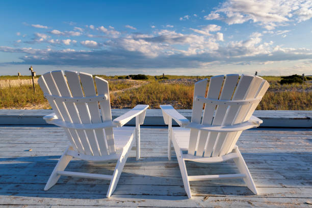 Beach chairs on Cape Cod beach Beach chairs on Cape Cod beach at sunset, Cape Cod, Massachusetts, USA. cape cod stock pictures, royalty-free photos & images