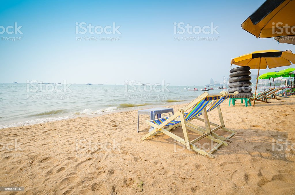 Beach chairs on perfect tropical white sand beach. royalty-free stock photo