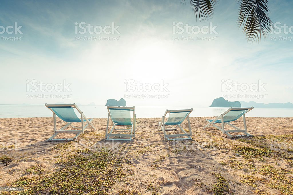 Beach chairs on perfect tropical white sand royalty-free stock photo