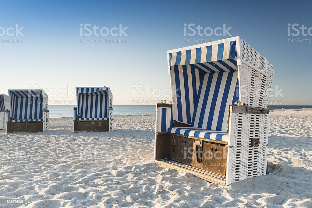 Beach - chairs on the island Sylt on sunset. Germany. stock photo