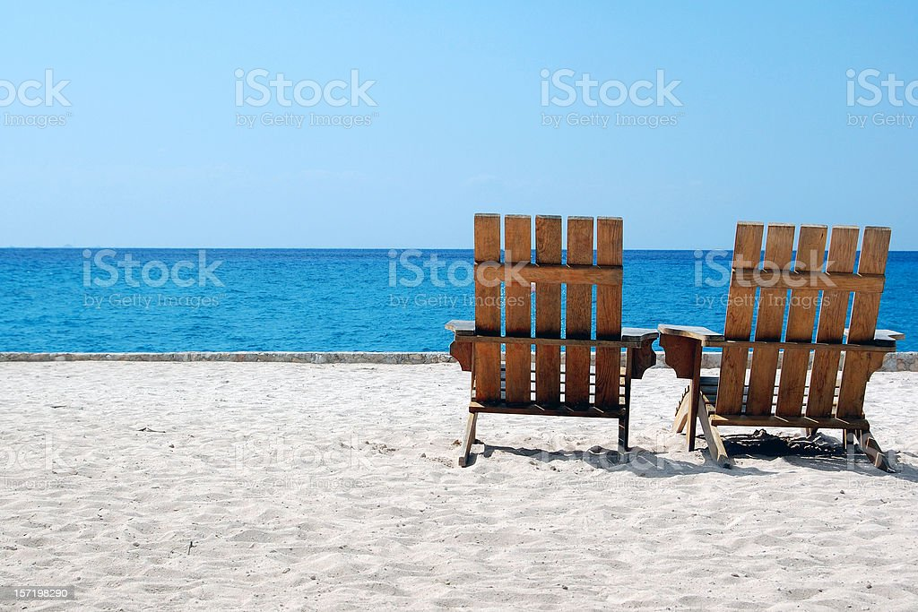 Beach Chairs on White Sand Overlooking Caribbean stock photo