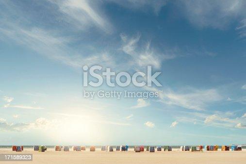 Beachchairs on the beach with a huge sky