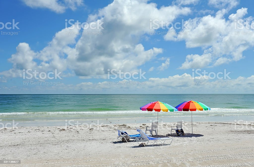 Beach Chairs with Bright Color Umbrellas stock photo