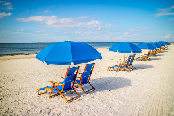 A beach Chaise Longue fronting the beach in Fort Myers, Florida stock photo