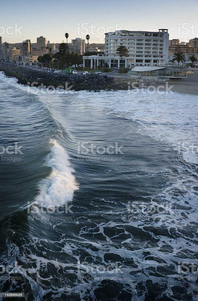 Beach Chile Vina del Mar Wave breaking at the beach of Vina del Mar, Chile. Sunrise colors the crest of the surf. Beach Stock Photo