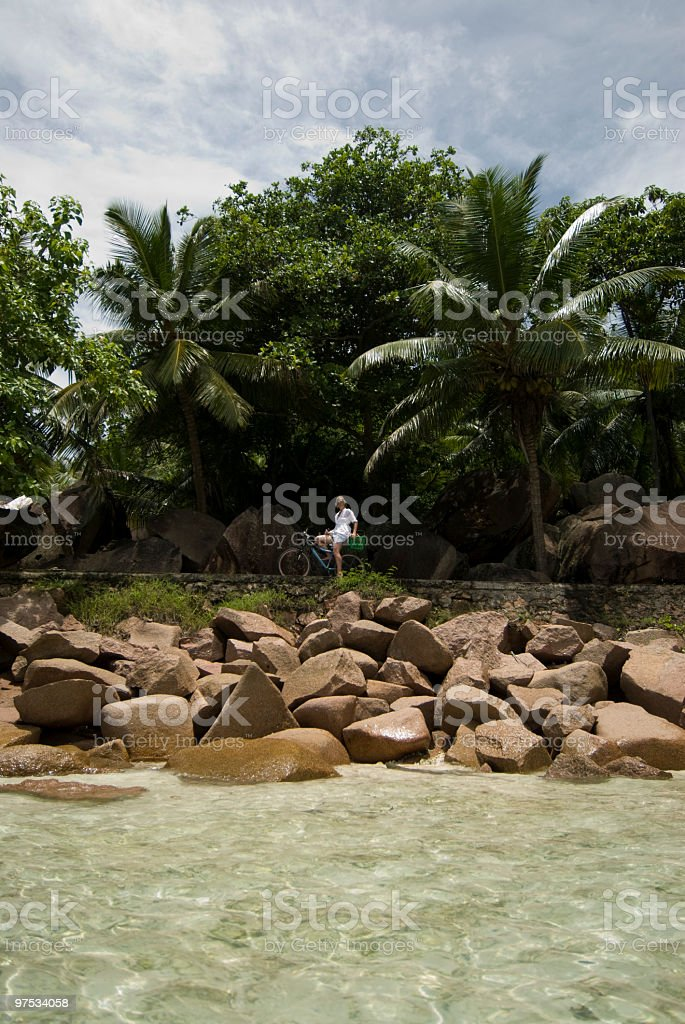 beach coconuts and cyclist royalty-free stock photo