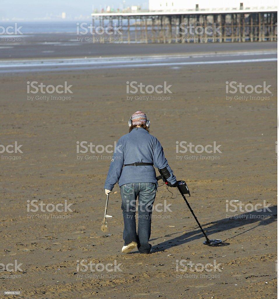 Beach combing woman royalty-free stock photo