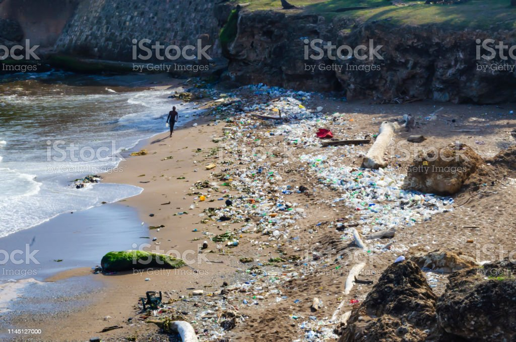 beach contaminated by garbage, plastics and wastewater in the city of Santo Domingo, Dominican Republic beach contaminated by garbage, plastics and wastewater in the city of Santo Domingo, Dominican Republic, where the color and smell is fetid due to pollution Backgrounds Stock Photo