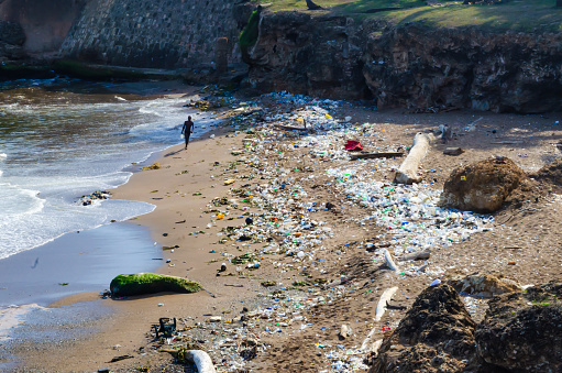 Beach Contaminated By Garbage Plastics And Wastewater In The City Of Santo Domingo Dominican Republic Stock Photo - Download Image Now