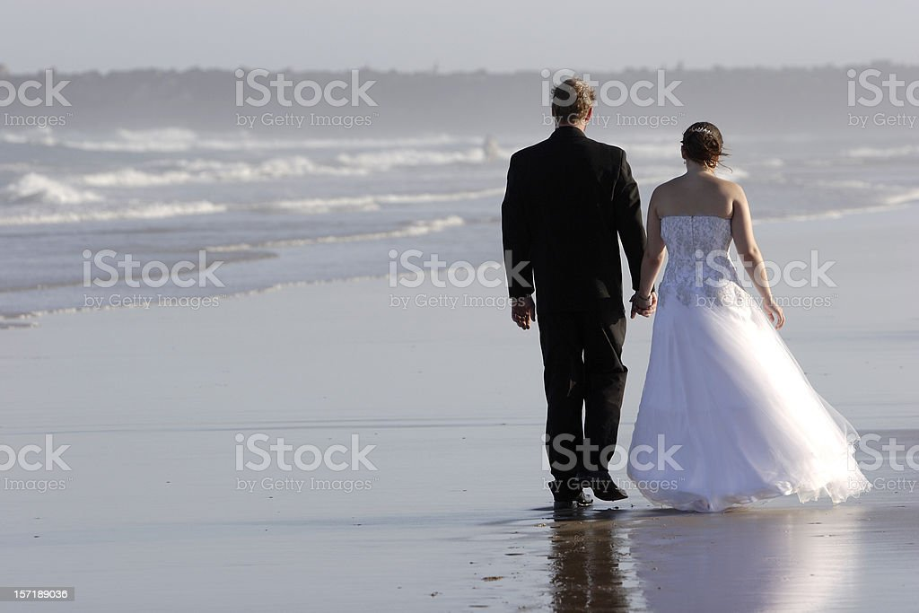 Beach Couple Walking royalty-free stock photo