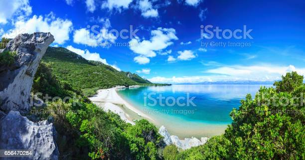 Beach Crystal Clear Water In Adriatic Sea And Green Mountains Stock Photo - Download Image Now