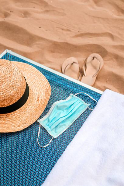 Beach Day with Covid-19 Corona Face Mask stock photo