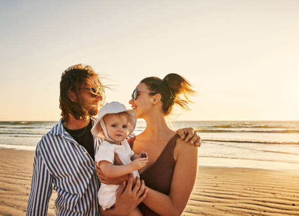 Beach days put the quality in quality time stock photo