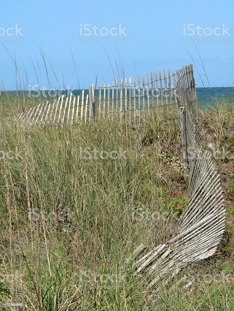 Beach Dunes & Broken Down Fence royalty-free stock photo