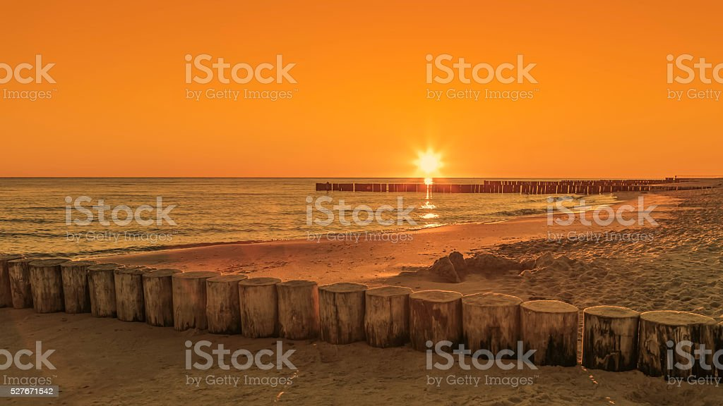 Beach during sunrise or sunset. stock photo