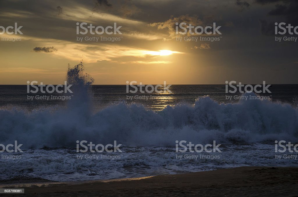 Beach during the beginning storm at sunset stock photo