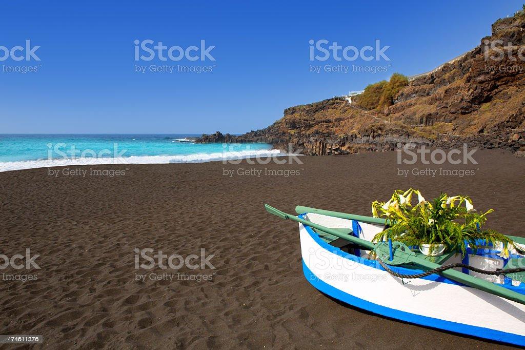 Beach el Bollullo black brown sand and aqua water stock photo