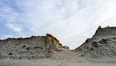 Beach entrance through tall sand dunes, island Ameland, the Netherlands