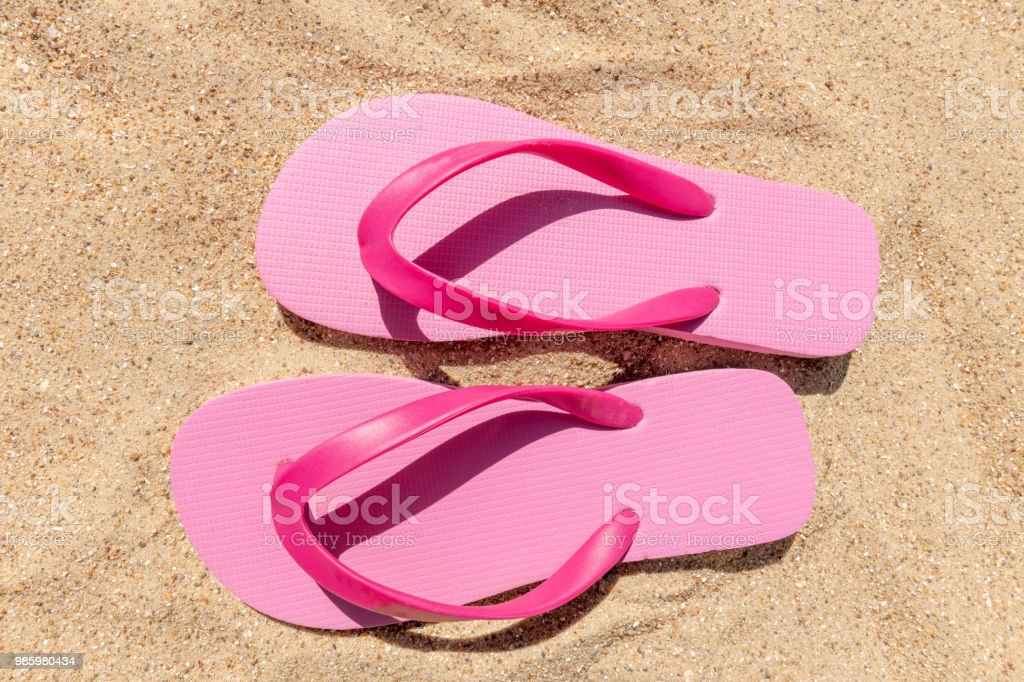 Beach essentials - pink flip-flops