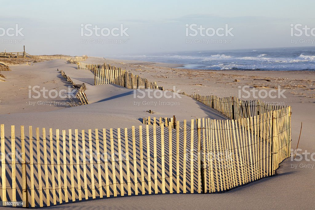 Beach Fence, Sand and the Ocean. stock photo
