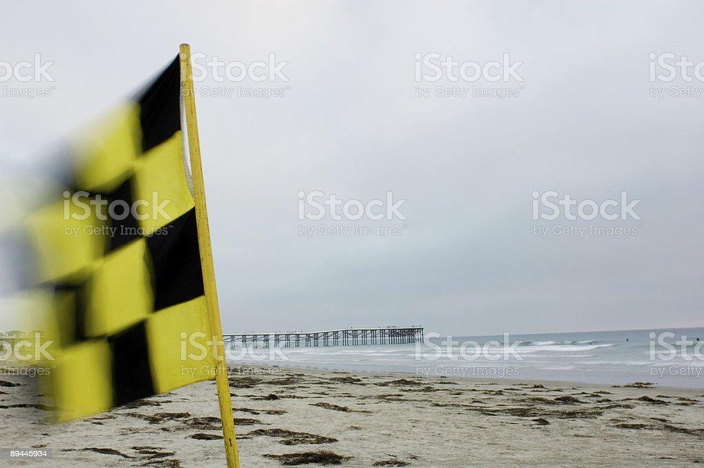 Drapeau de la plage et de la jetée photo libre de droits