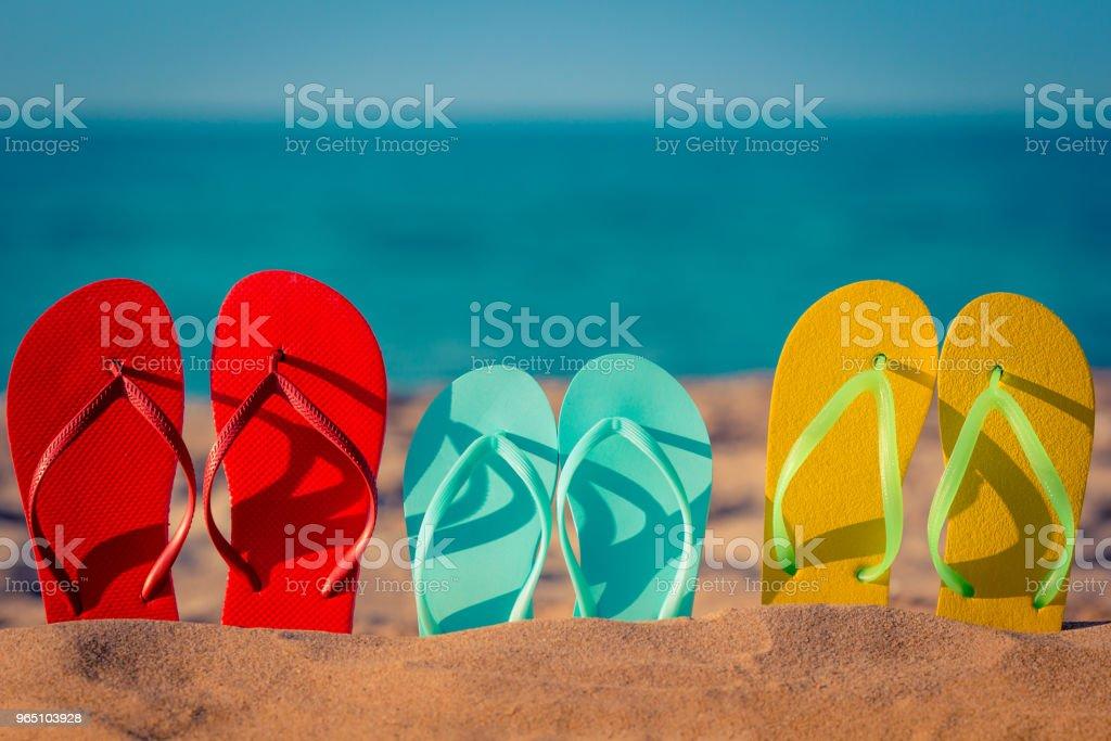 Beach flip-flops on the sand zbiór zdjęć royalty-free