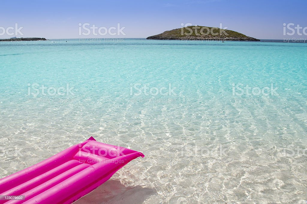 beach floating lounge pink tropical sea Formentera stock photo