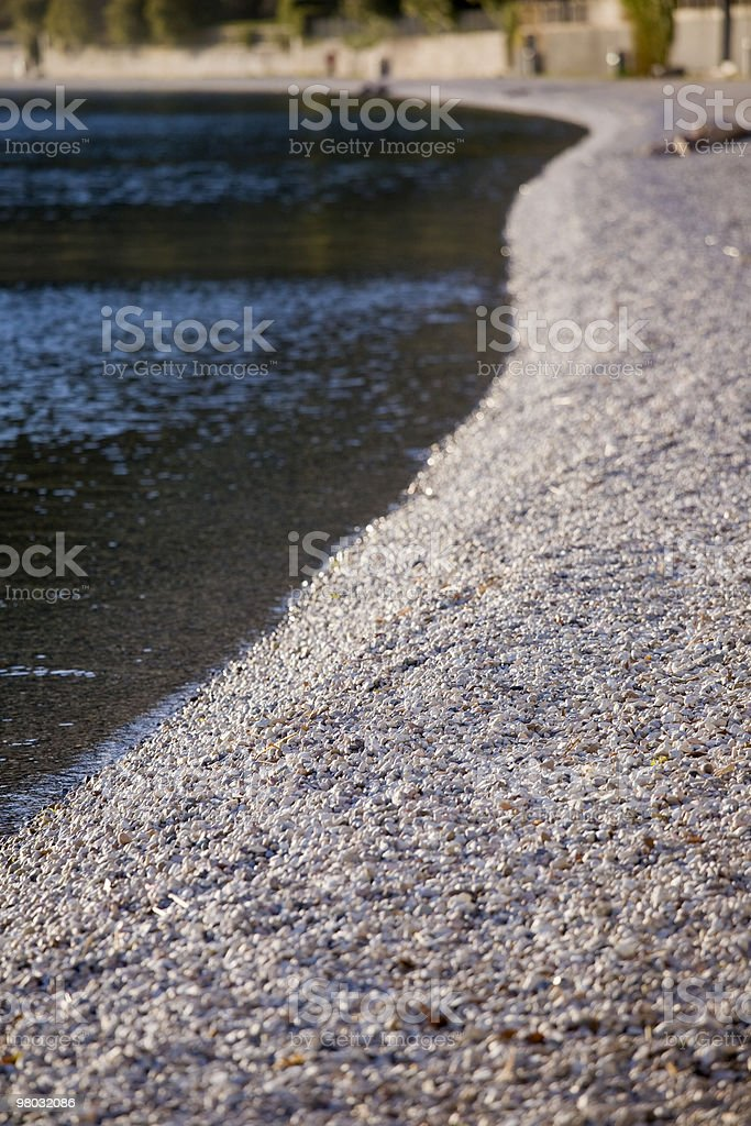 beach formed by rocks royalty-free stock photo