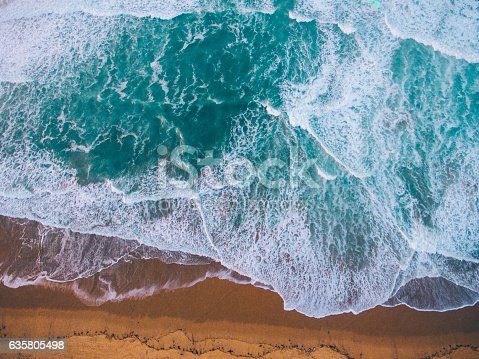 Detail of sand and the ocean.