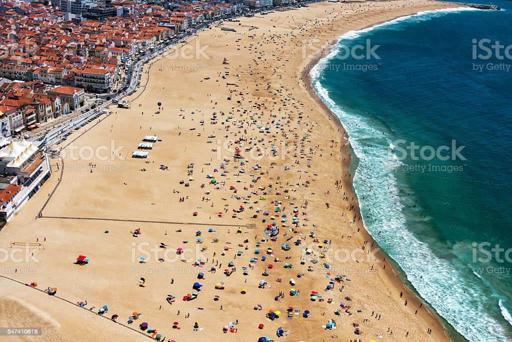 Beach from Above with Many Umbrellas and People stock photo