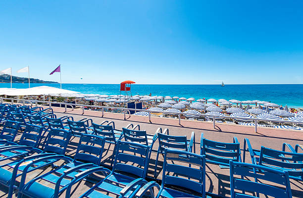Beach front chairs and parasols in Nice, France stock photo