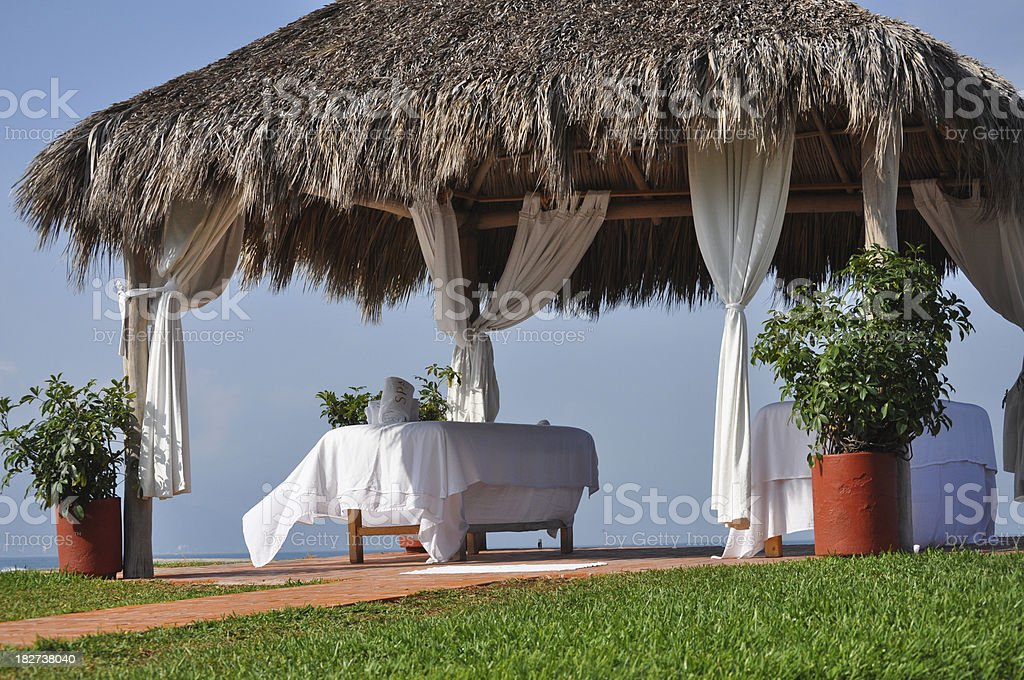 Beach Front Massage table and cabana in Mexico stock photo
