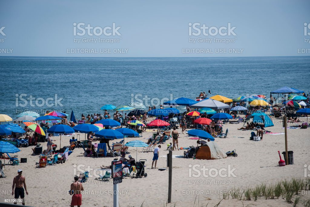 Beach Full of Vacationers at Bethany Beach stock photo