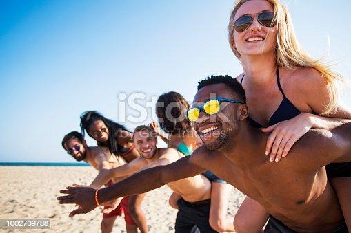 Friends at beach have fun