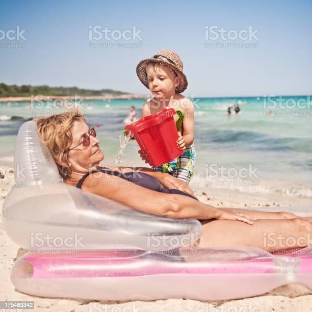 On beach granny Woman Filmed
