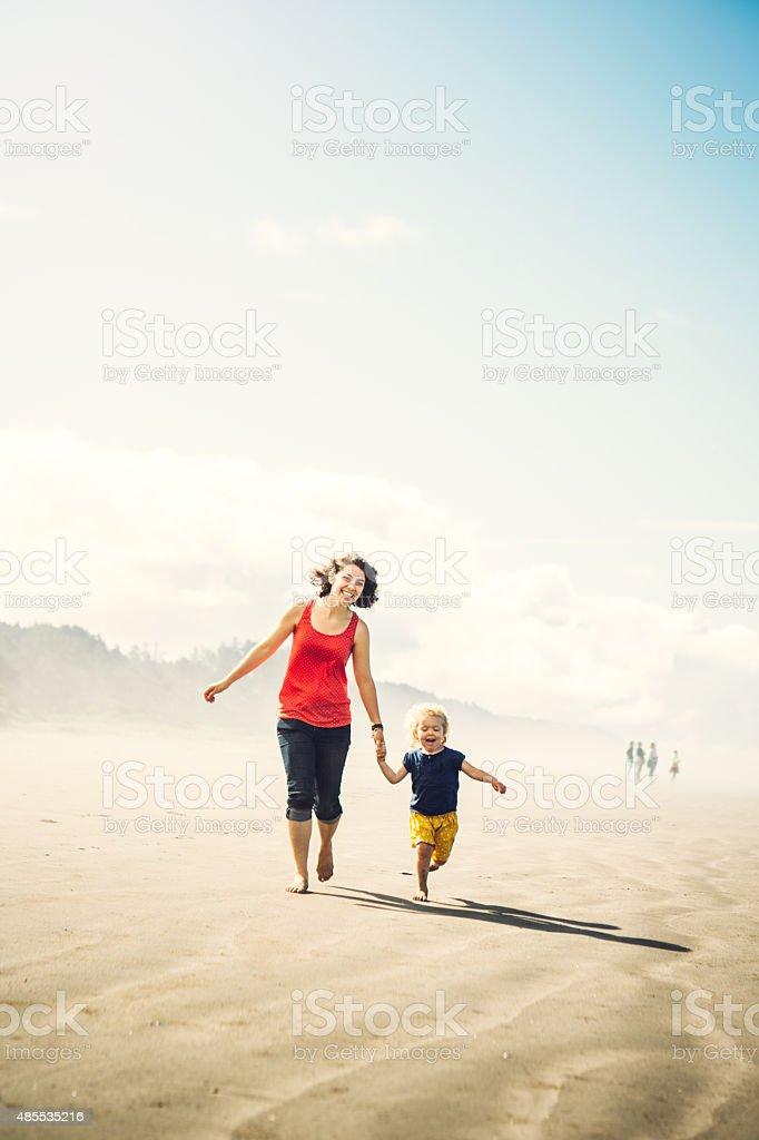 Beach Girls Running Hand in Hand stock photo