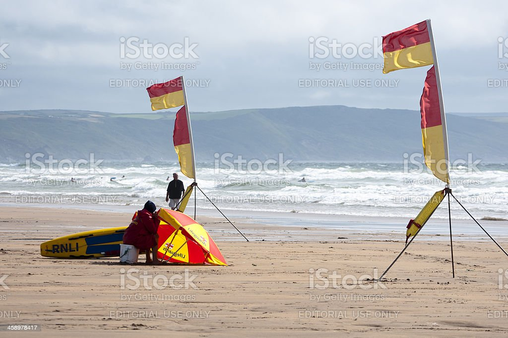 RNLI beach guard duty at Bude in Cornwall royalty-free stock photo