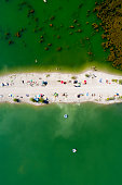 Beach from above with swimming and sunbathing people in Germany