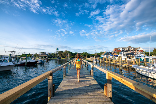 Girl walking on Ocracoke pier